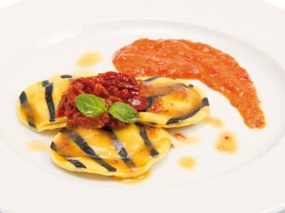 Codfish ravioli with peppers cream and dried tomato fillets